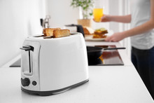 Toaster With Bread Slices On K...