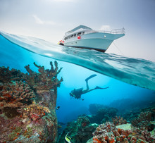 Split Photography Of Safari Yacht And Diver