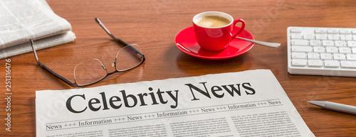 Obraz na plátně A newspaper on a wooden desk - Celebrity News