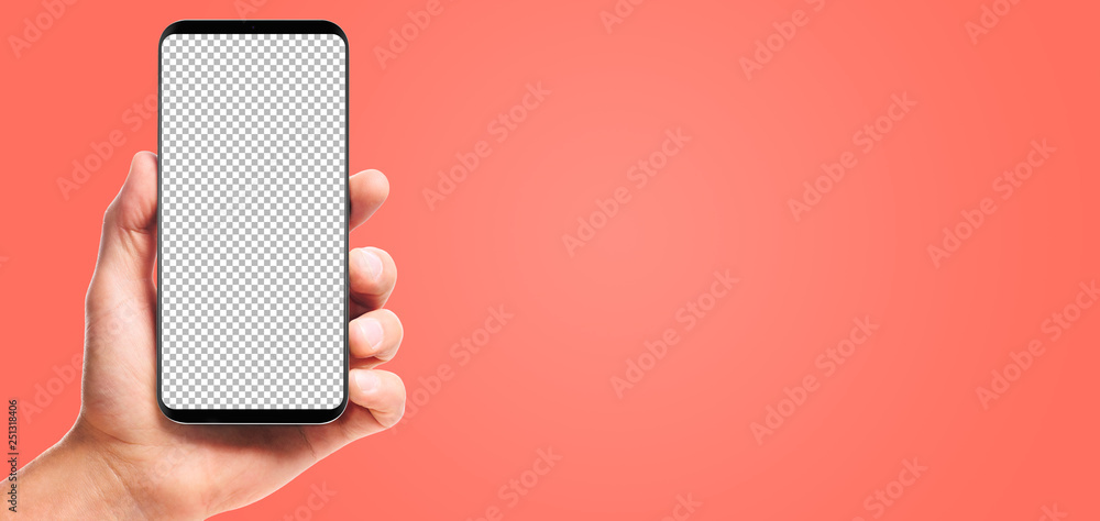Fototapety, obrazy: male hand holding bezel-less smartphone with transparent screen, isolated on living coral background . Screen is cut out with path