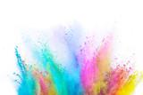 Fototapeta Tęcza - Colored powder explosion on white background. Freeze motion.
