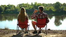 Couple Sitting And Enjoying Beautiful River Scape, Man Drinking Beer, Addiction