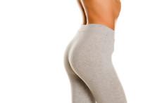 Sexy Slim Female Buttocks In Gray Leggingss On White Background