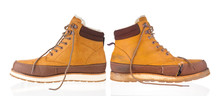 New And Used Yellow Winter Boots On White Background