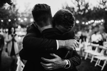 A Groom Is Hugging With A Best...