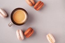 Morning Cup Of Coffee And Dessert Macaron Or Macaroon Top View. Flat Lay Style.