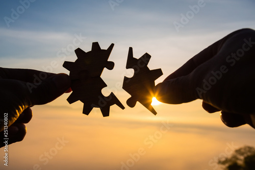 Obraz Silhouette Woman hands connecting couple puzzle piece against sunrise, Business solutions, target, success, goals and strategy concepts - fototapety do salonu