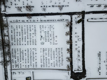 Aerial View Of Cemetery In Winter. Snow Covered Graves In Switzerland.