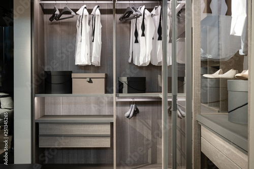 Valokuva  Wardrobe with different stuff, shoes and male clothes