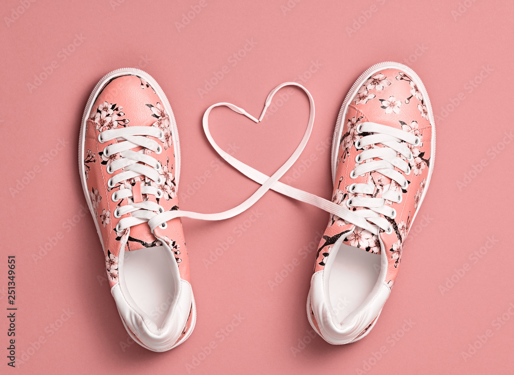 Fototapeta Coral colored Love, Hipster Set. Fashion Trendy Trainers with Heart. Vanilla color. Minimal Style. Summer Floral coral Sneakers. Flat lay. Art Design. Valentines day