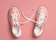 canvas print picture - Coral colored Love, Hipster Set. Fashion Trendy Trainers with Heart. Vanilla color. Minimal Style. Summer Floral coral Sneakers. Flat lay. Art Design. Valentines day