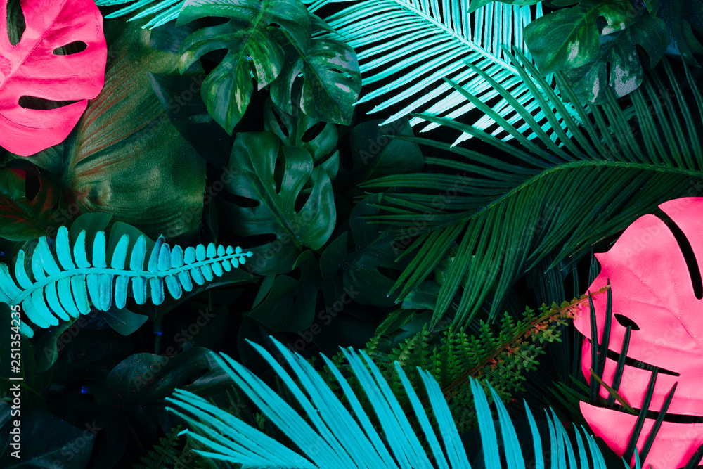 Fototapeta Creative fluorescent color layout made of tropical leaves. Flat lay neon colors. Nature concept.