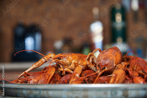 Fotografía  Boiled crayfish on a plate