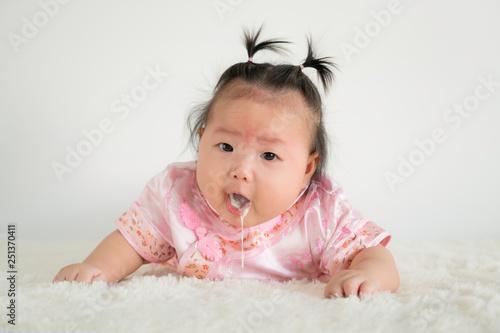 Obraz na plátně  Baby girl Infant four months vomiting milk.