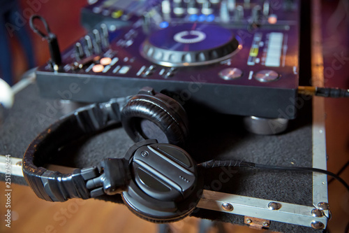Professional dj headphones on cd player turntable deck in