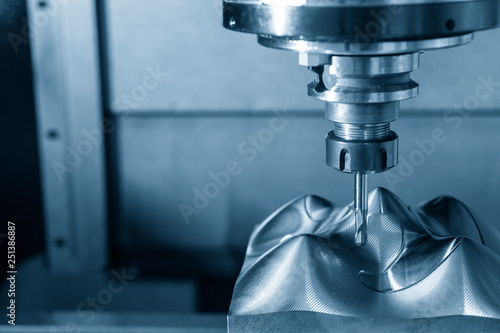 Fototapeta The  CNC milling machine cutting the mould part with the solid ball end mill tool