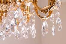 Golden Chandelier Close-up. Beautiful Vintage Crystal Chandelier Hanging On A Ceiling.