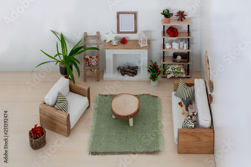 Photo  Light interior of a dollhouse living room furnished with wooden handmade furnitu
