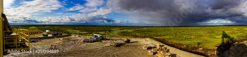 Poster Airport view of the swamp from the rig before the rain construction site panorama