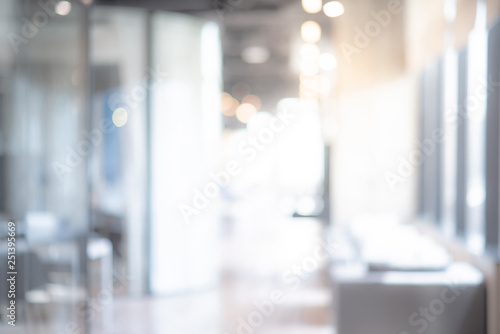 Obraz Abstract blurred office interior room. blurry working space with defocused effect. use for background or backdrop in business concept - fototapety do salonu