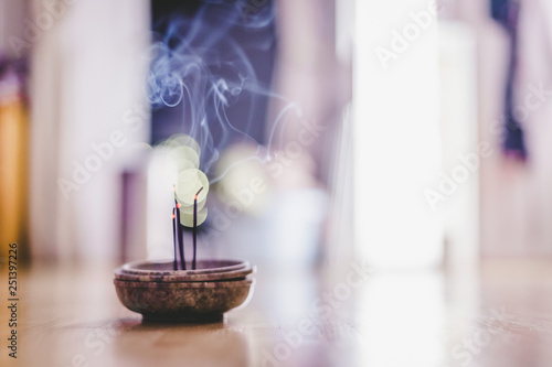 Stampa su Tela Smoking and smelling joss sticks at home, feng shui; Copy space