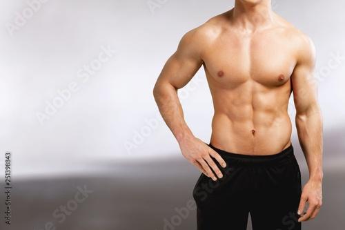 Obraz Cropped image of fit muscular body of sportsman - fototapety do salonu