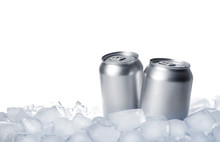 Tin Cans On Ice Cubes Against White Background