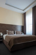 hotel room interior with bed in brown color