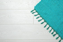 Color Woven Carpet On Wooden B...