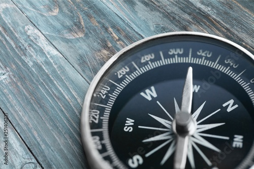 Brass antique compass  on background Fototapeta