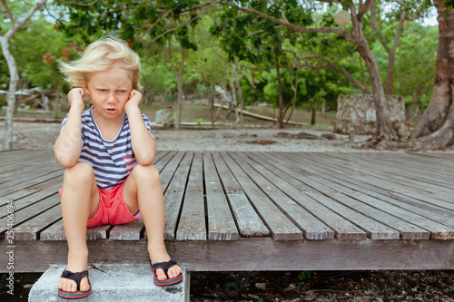 Funny portrait of caucasian kid looking annoyed and unhappy Fototapeta