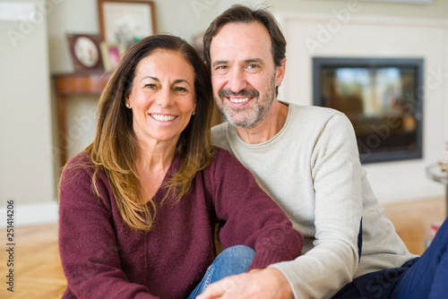 Fotografia, Obraz  Beautiful romantic couple sitting together on the floor at home