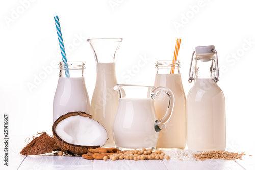 Various types of all-vegetable and organic milk in glass containers