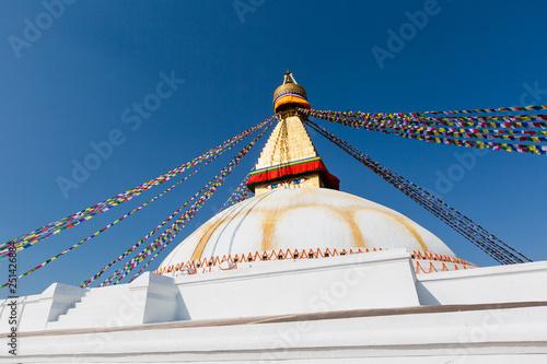Staande foto Nepal Boudhanath in Nepal. Cultural heritage in Kathmandu. The Biggest Tibetan temple. Nepalese prayer flags.