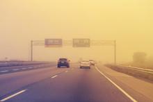 Traffic On Highway In Fog Mist...