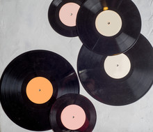 Gramophone Record Of Different Sizes On A Light Background. View From Above