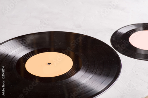 gramophone record of different sizes on a light background - 251431214