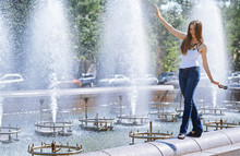 Woman Walking By Water Fountain