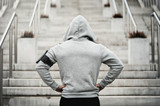 Fototapeta Na drzwi - Rear view of hooded sports man about to run upstairs