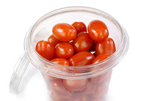 Cherry Plum Tomatoes In Plastic Container Packed.