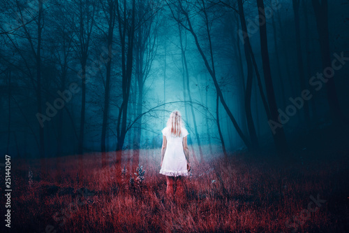 Naklejki Fantasy woman-standing-in-foggy-mysterious-fantasy-forest-with-grass-on-the-floor-the-image-with-the-effect-of-double-exposure