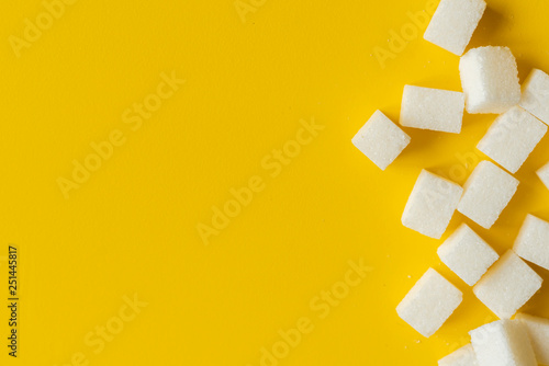 Fotografie, Obraz  sugar cube on yellow background isolated design mockup b