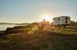 Chile, Talca, Rio Maule, camper at lake with woman and dog at sunset