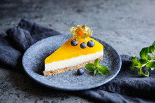 No Bake Mango Cheesecake Decorated With Blueberries And Physalis