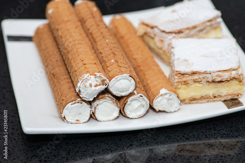 Valokuva  Party platter with arranged sweet desserts from a bakery on banquet table at business or wedding event venue
