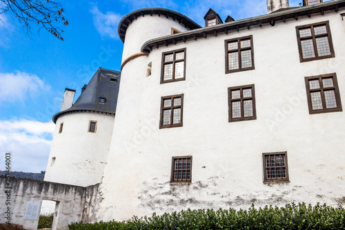 Photo  The buildings of Clervaux Castle on a cloudy February day, exterior partial view