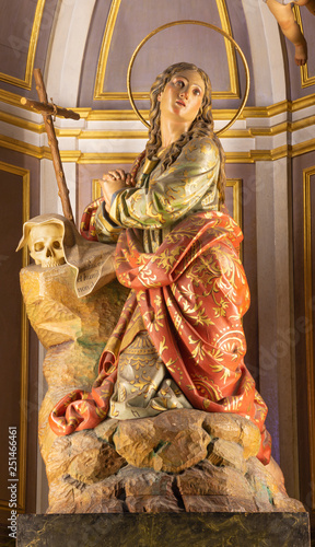 PALMA DE MALLORCA, SPAIN - JANUARY 29, 2019: The polychome carved sculpture of St. Mary of Magdalen in the church Iglesia de Santa Maria Magdalena by Lluís Font i Martorell (1839-1904).