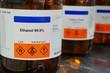 Leinwanddruck Bild - Bottle of Ethanol, C2H6O with Properties information and its chemical hazard warning symbols. Flammable symbol, Inhalation hazard symbol.