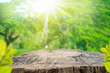 canvas print picture - Blur green nature bokeh with sun light on copy space empty old wood table abstract background.