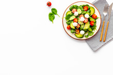 Fresh Salad With Mozzarella, Spinach, Cherry Tomatoes, Cucumber On Plate On White Background Top View Copy Space
